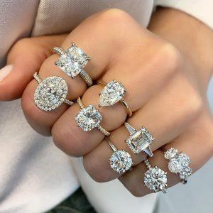 multiple rose yellow white gold engagement rings on ladies hand diamond moissanite