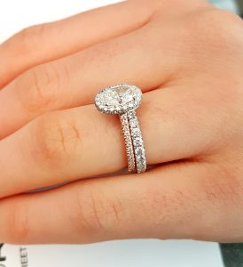 oval halo engagement ring with matching band