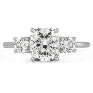 cushion cut diamond three-stone engagement ring round diamond side stones
