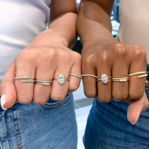 oval diamond engagement rings on ladies hand with lb studio jewelry pieces