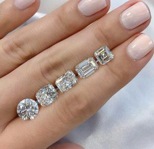 asscher round cushion radiant emerald diamonds on ladies hand