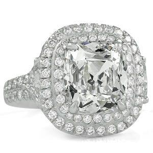 3.28 carat antique cushion diamond three stone engagement ring halo white gold