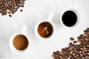 coffee cups filled and coffee beans