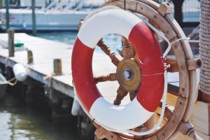 red and white lifeguard ring at boat dock