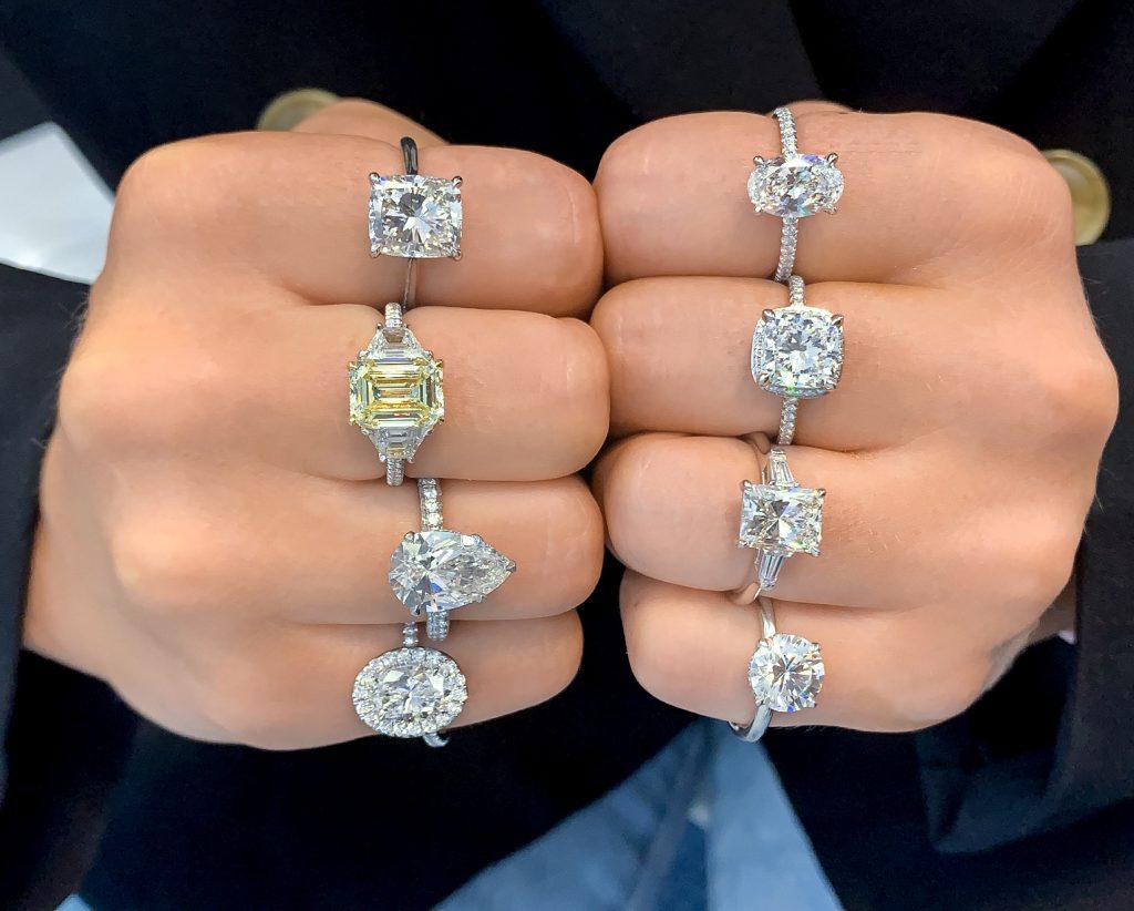 ladies hands multiple various style engagement rings diamond moissanite yellow