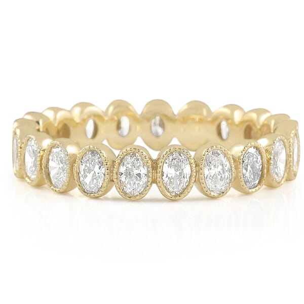 oval shape yellow gold bezel eternity band