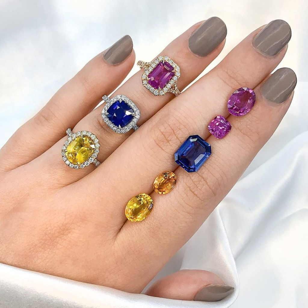sapphire rings and stones on hand